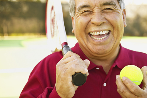 Bend, OR man smiling about his successful root canal procedure by his dentist.